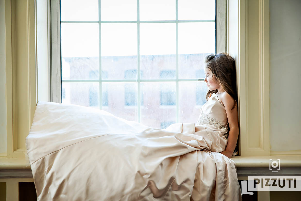 Little girl in her mother's wedding dress